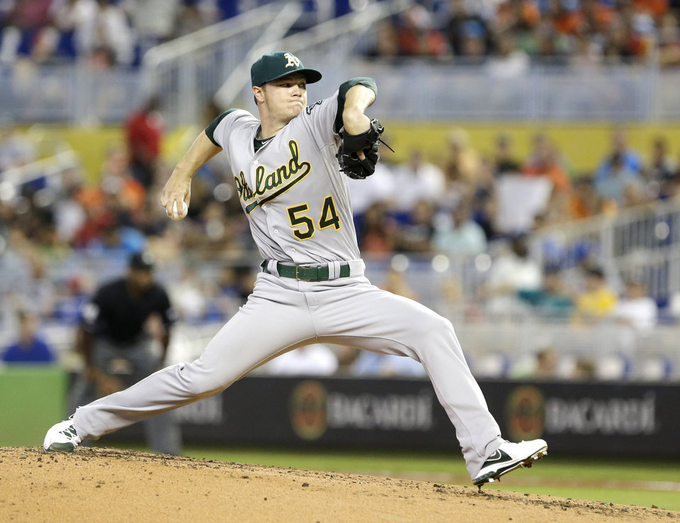 Photo - Oakland Athletics' Sonny Gray delivers a pitch during the first inning of a baseball game against the Miami Marlins, Saturday, June 28, 2014 in Miami. (AP Photo/Wilfredo Lee)