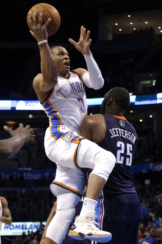 Photo - Oklahoma City's Russell Westbrook (0)  goes up for a dunk as Charlotte Al Jefferson (25) defends during the NBA basketball game between the Oklahoma City Thunder and the Charlotte Bobcats at the Chesapeake Energy Arena, Sunday, March 2, 2014. Photo by Sarah Phipps, The Oklahoman