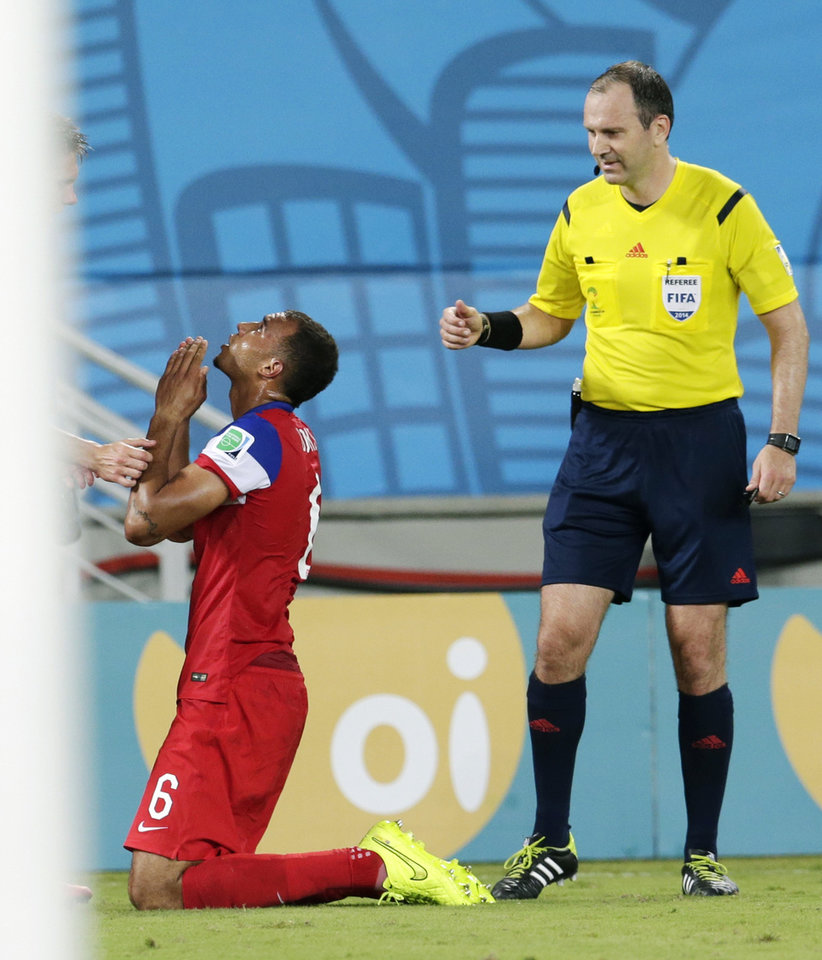Photo - United States' John Brooks kneels in the corner after scoring his side's second goal during the group G World Cup soccer match between Ghana and the United States at the Arena das Dunas in Natal, Brazil, Monday, June 16, 2014. The United States defeated Ghana 2-1.  (AP Photo/Petr David Josek)