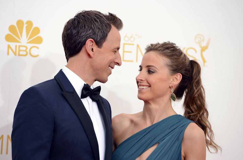 Photo - Host Seth Meyers, left, and Alexi Ashe arrive at the 66th Annual Primetime Emmy Awards at the Nokia Theatre L.A. Live on Monday, Aug. 25, 2014, in Los Angeles. (Photo by Jordan Strauss/Invision/AP)