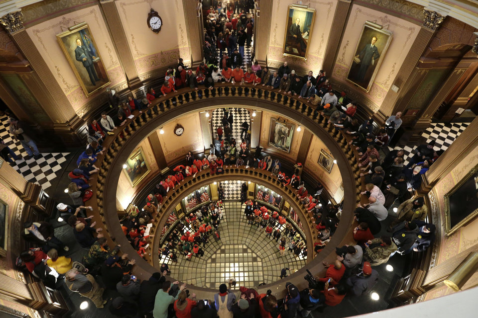 Protesters gather for a rally in the State Capitol rotunda in Lansing, Mich., Tuesday, Dec. 11, 2012. The crowd is protesting right-to-work legislation passed last week. Michigan could become the 24th state with a right-to-work law next week. Rules required a five-day wait before the House and Senate vote on each other\'s bills; lawmakers are scheduled to reconvene Tuesday and Gov. Snyder has pledged to sign the bills into law. (AP Photo/Paul Sancya)