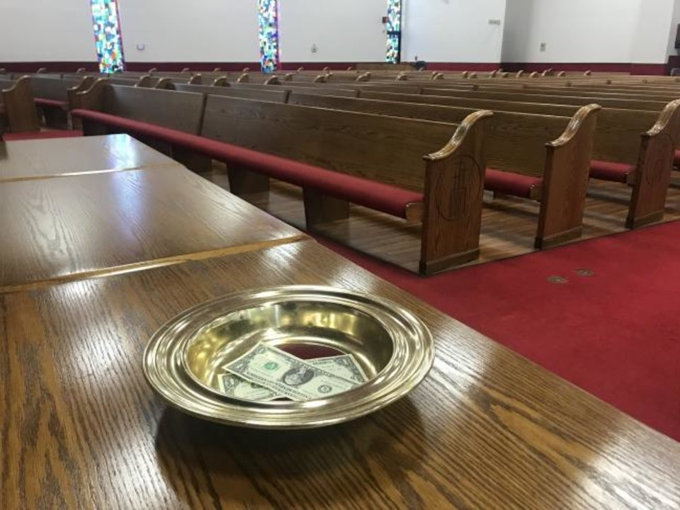 Photo -  An offering plate is shown at St. John Missionary Baptist Church in Oklahoma City. [Carla Hinton/The Oklahoman]
