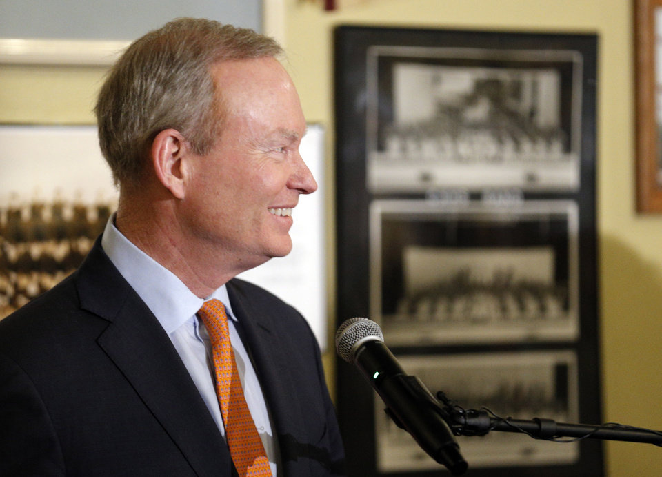 Photo -  Mayor Mick Cornett talks with supporters Tuesday after winning the Oklahoma City mayoral race. Photo by Sarah Phipps, The Oklahoman   SARAH PHIPPS -