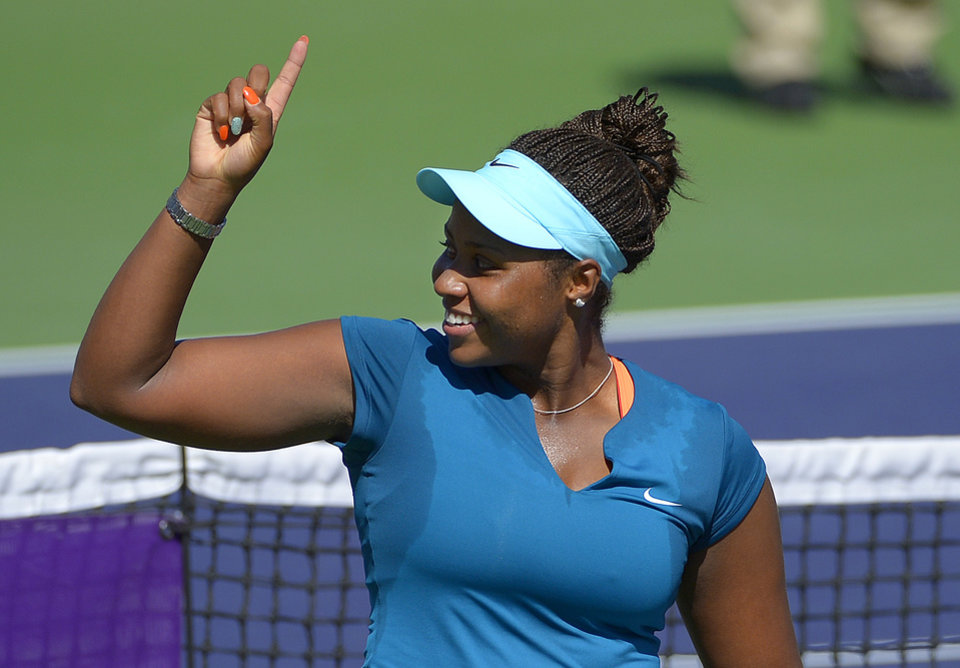 Photo - Taylor Townsend celebrates after beating Karin Knapp, of Italy, in a first round match at the BNP Paribas Open tennis tournament, Thursday, March 6, 2014, in Indian Wells, Calif. Townsend won 7-6, 6-1. (AP Photo/Mark J. Terrill)