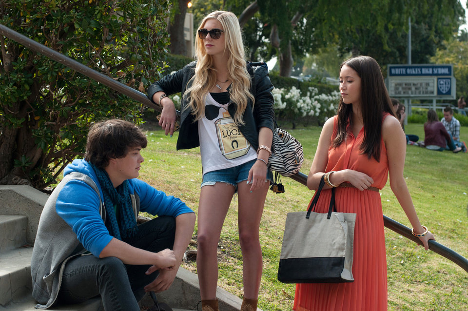 Photo - This publicity image released by A24 Films shows, from left, Israel Broussard, Claire Vivien and Katie Chang in a scene from