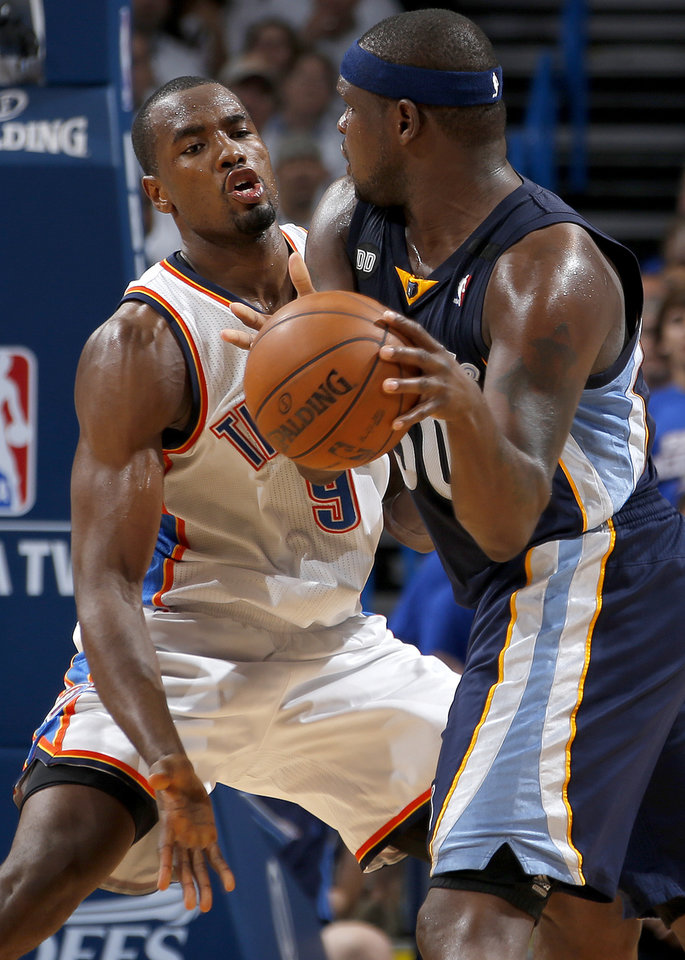 Oklahoma City's Serge Ibaka (9) defends Memphis' Zach Randolph (50) during Game 2 in the second round of the NBA playoffs between the Oklahoma City Thunder and the Memphis Grizzlies at Chesapeake Energy Arena in Oklahoma City, Tuesday, May 7, 2013. Photo by Bryan Terry, The Oklahoman
