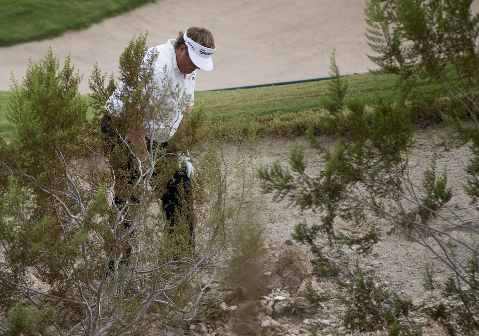 Photo -   Tim Herron looks for his ball in the rough near the third green during the second round of the Justin Timberlake Shriners Hospitals for Children Open golf tournament, Friday, Oct. 5, 2012, in Las Vegas. Herron took a drop on the hole. (AP Photo/Julie Jacobson)