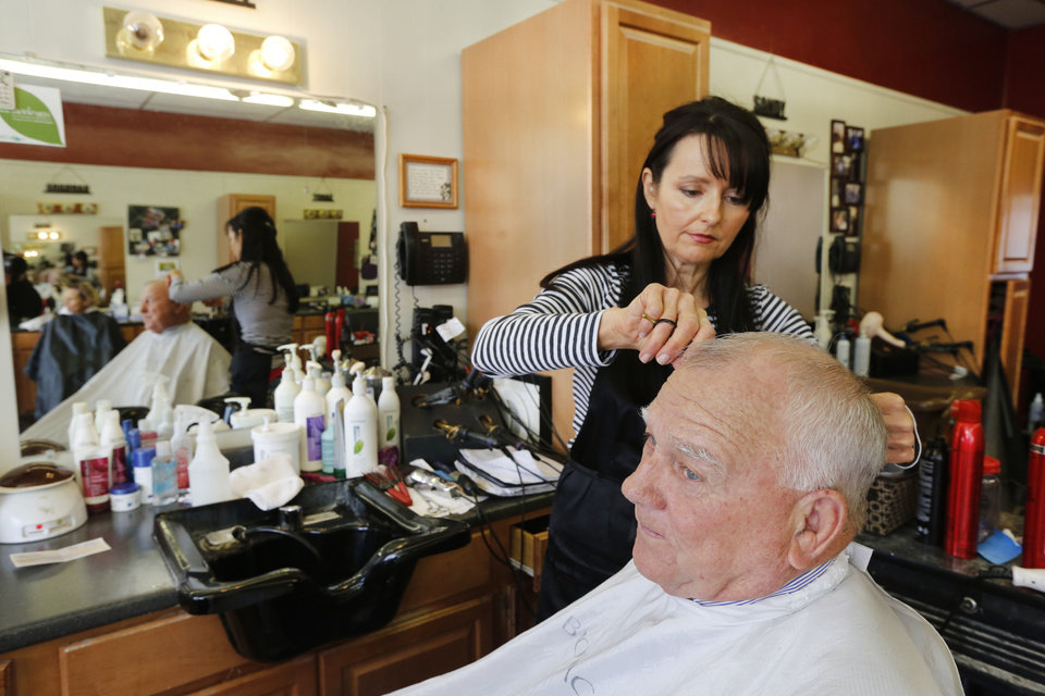 Photo - Kathy Grider, owner of the Natural Look Salon, in Purcell, gives Sam Stark a haircut on Monday, Feb. 3, 2014. Both live in Lexington, but now have to make a 94 mile round trip drive since the State Department of Transportation closed The James C. Nance Memorial Bridge, U.S. 77/State Highway 39, that links Purcell and Lexington, Friday, Jan. 31, 2014. The bridge was closed after an inspection revealed cracking in the beams. Photo By Steve Gooch, The Oklahoman