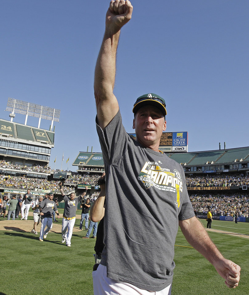 Photo -   Oakland Athletics manager Bob Melvin celebrates after the A's clinched the AL West title after defeating the Texas Rangers 12-5 in a baseball game, Wednesday, Oct. 3, 2012, in Oakland, Calif. (AP Photo/Ben Margot)