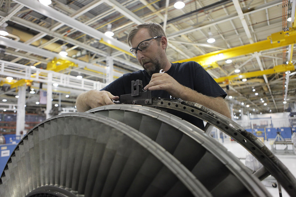 TINKER MAINTENANCE FACILITIES: Kelly Roberts works on an aircraft engine fan at Tinker Air Force Base in Midwest City, Tuesday, July 3, 2012.  The Oklahoman Archives