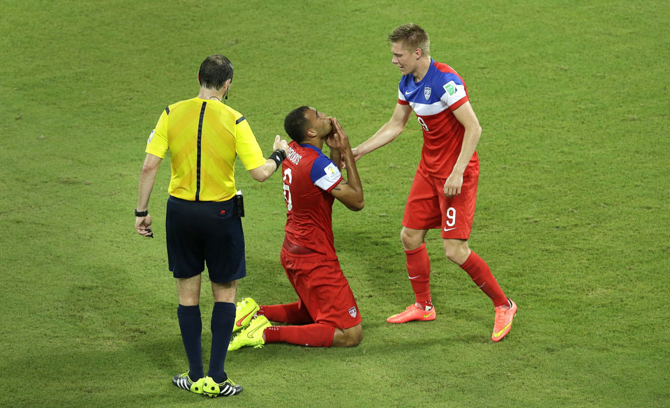 Photo - United States' John Brooks, center, celebrates with teammate Aron Johannsson after scoring their second goal during the group G World Cup soccer match between Ghana and the United States at the Arena das Dunas in Natal, Brazil, Monday, June 16, 2014. The United States defeated Ghana 2-1. (AP Photo/Hassan Ammar)
