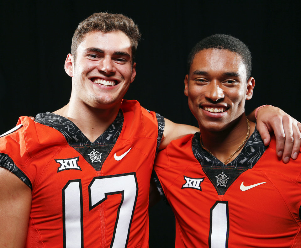 Photo -  Oklahoma State receivers coach Kasey Dunn says that Dillon Stoner, left, and Jalen McCleskey
