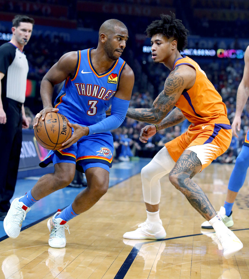 Photo - Oklahoma City's Chris Paul (3) looks to get around Phoenix's Kelly Oubre Jr. (3) during the NBA basketball game between the Oklahoma City Thunder and the Phoenix Suns at the Chesapeake Energy Arena in Oklahoma City , Friday, Dec. 20, 2019.   [Sarah Phipps/The Oklahoman]