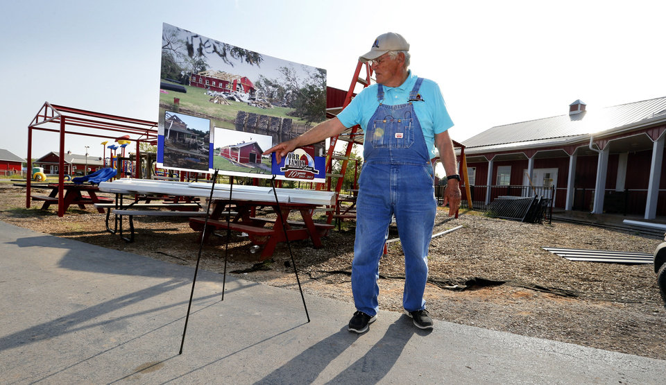 Photo - A photograph of damage from May's tornado shows contrast as Dr. Glenn Orr gives a tour of new and repaired buildings at Orr Family Farms on Thursday, Sept. 12, 2013 in Oklahoma City, Okla.  Photo by Steve Sisney, The Oklahoman