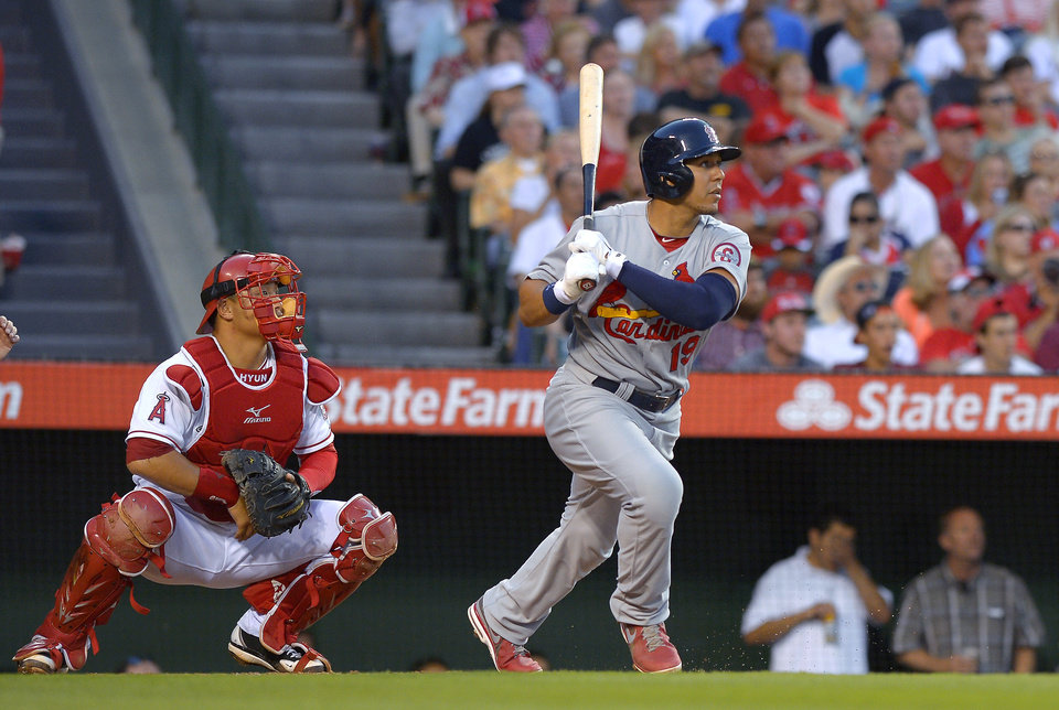Photo - St. Louis Cardinals' Jon Jay watches his two-run home run in front of Los Angeles Angels catcher Hank Conger during the second inning of a baseball game, Wednesday, July 3, 2013, in Anaheim, Calif. (AP Photo/Mark J. Terrill)