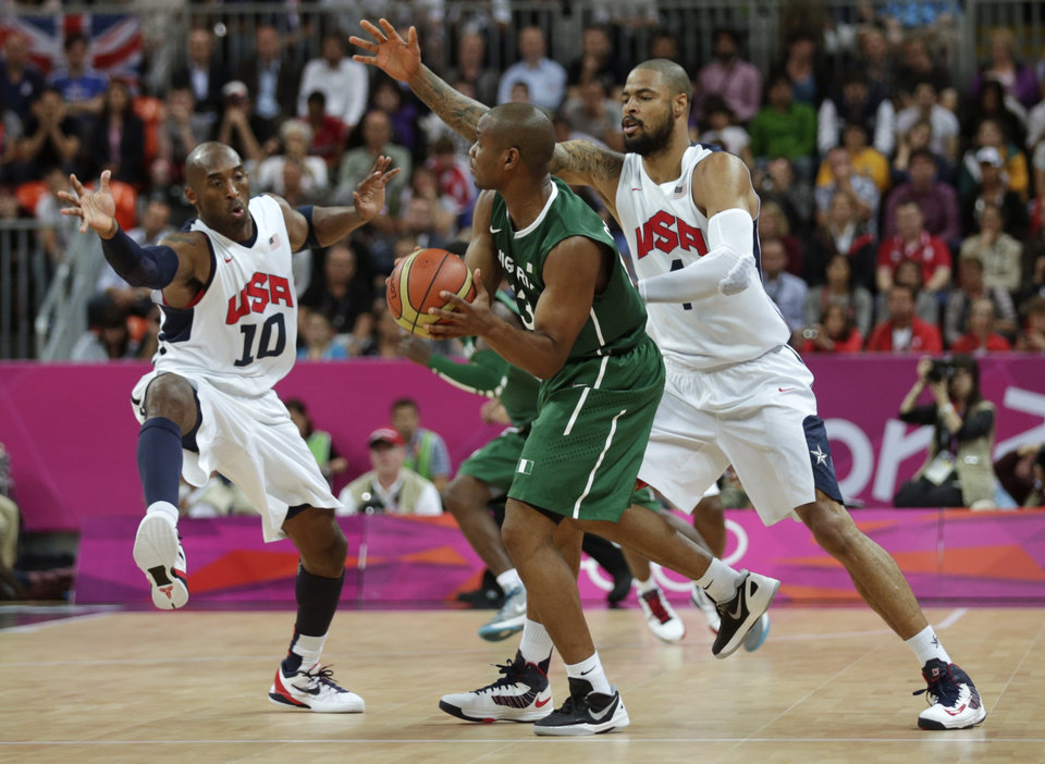 Photo -   USA's Kobe Bryant, left, and Tyson Chandler trap Nigeria's Derrick Obasohan during a men's basketball game at the 2012 Summer Olympics, Thursday, Aug. 2, 2012, in London. (AP Photo/Charles Krupa)