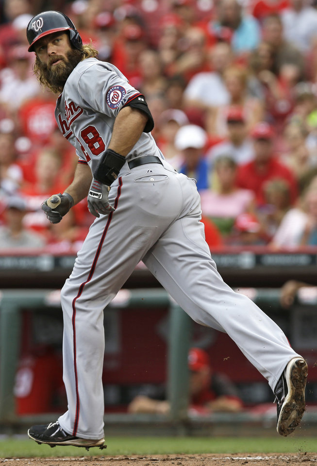 Photo - Washington Nationals' Jayson Werth jogs to first base after being walked by Cincinnati Reds starting pitcher Mat Latos with the bases loaded to score a run in the fifth inning of a baseball game, Sunday, July 27, 2014, in Cincinnati. (AP Photo/Al Behrman)