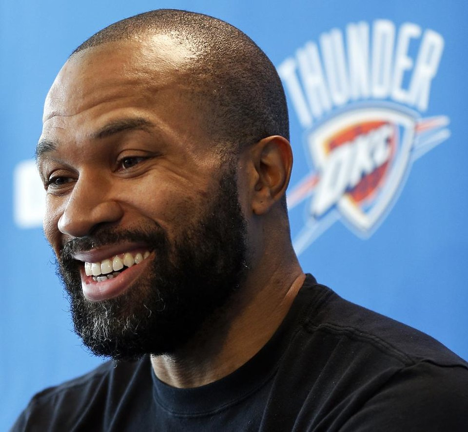Photo - Derek Fisher laughs during exit interviews with the media for the Oklahoma City Thunder at the team's practice facility in Oklahoma City, Sunday, June 1, 2014. The Photo by Nate Billings, The Oklahoman