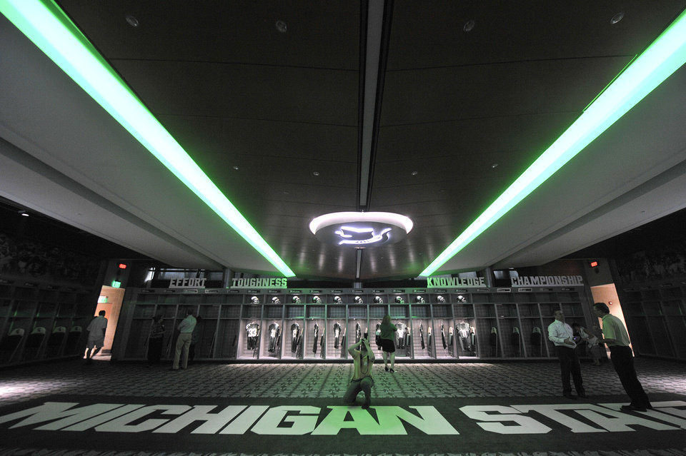 Photo - In this Monday, Aug. 25, 2014, photo, people visit the new locker room during a tour of the new North End Zone Complex renovations at Spartan Stadium on the Michigan State Campus in East Lansing, Mich. (AP Photo/Detroit Free Press, Ryan Garza)  DETROIT NEWS OUT, TV OUT, INTERNET OUT, MAGS OUT, NO SALES, MANDATORY CREDIT DETROIT FREE PRESS