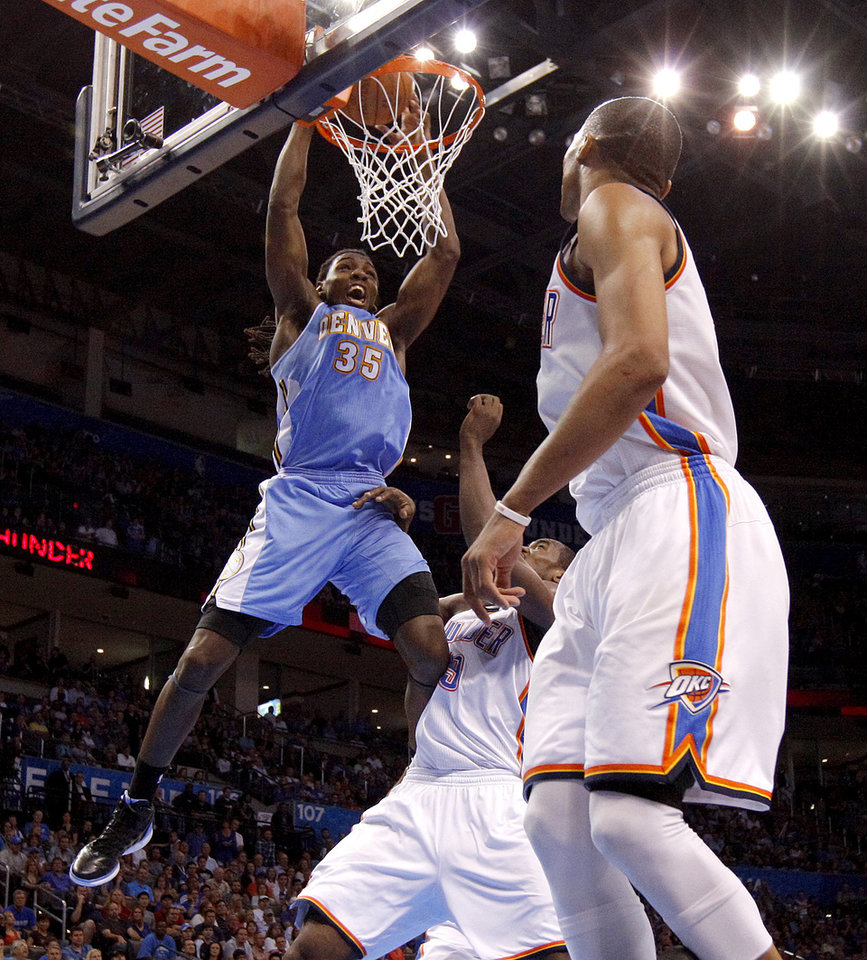 Denver's Kenneth Faried (35) dunks the ball beside Oklahoma City's Serge Ibaka (9) during the NBA basketball game between the Oklahoma City Thunder and the Denver Nuggets at Chesapeake Energy Arena in Oklahoma City, Wednesday, April 25, 2012. Oklahoma City lost 106-101.  Photo by Bryan Terry, The Oklahoman