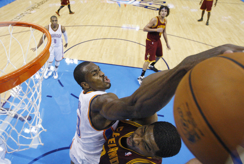 Oklahoma City Thunder forward Serge Ibaka (9) reaches in to block a shot by Cleveland Cavaliers forward Tristan Thompson, right, in the third quarter of an NBA basketball game in Oklahoma City, Sunday, Nov. 11, 2012. Oklahoma City won 106-91. (AP Photo/Sue Ogrocki)