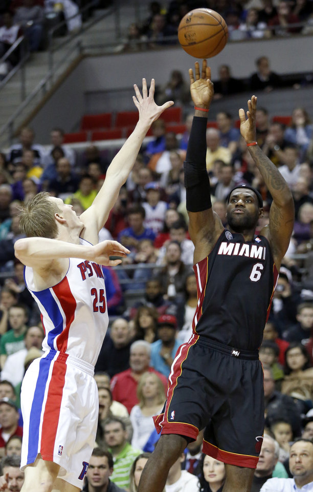 Miami Heat forward LeBron James (6) takes a shot against Detroit Pistons forward Kyle Singler (25) in the first half of an NBA basketball game Friday, Dec. 28, 2012, in Auburn Hills, Mich. (AP Photo/Duane Burleson)