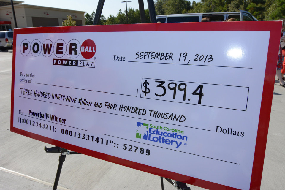 Photo - A giant check is displayed announcing a winner in the Powerball outside Murphy Express store on Thursday, Sept. 19, 2013  in Lexington, S.C.  A $400 million winning ticket in the latest Powerball drawing was sold at the service station just off I-20 west of Columbia, officials with the South Carolina Education Lottery said Thursday.  Winners in South Carolina do not have to come forward publicly but Lottery Executive Director Paula Harper Bethea noted that, in order to claim the winnings, the ticketholder must contact state lottery officials within 180 days.  (AP Photo/ Richard Shiro)