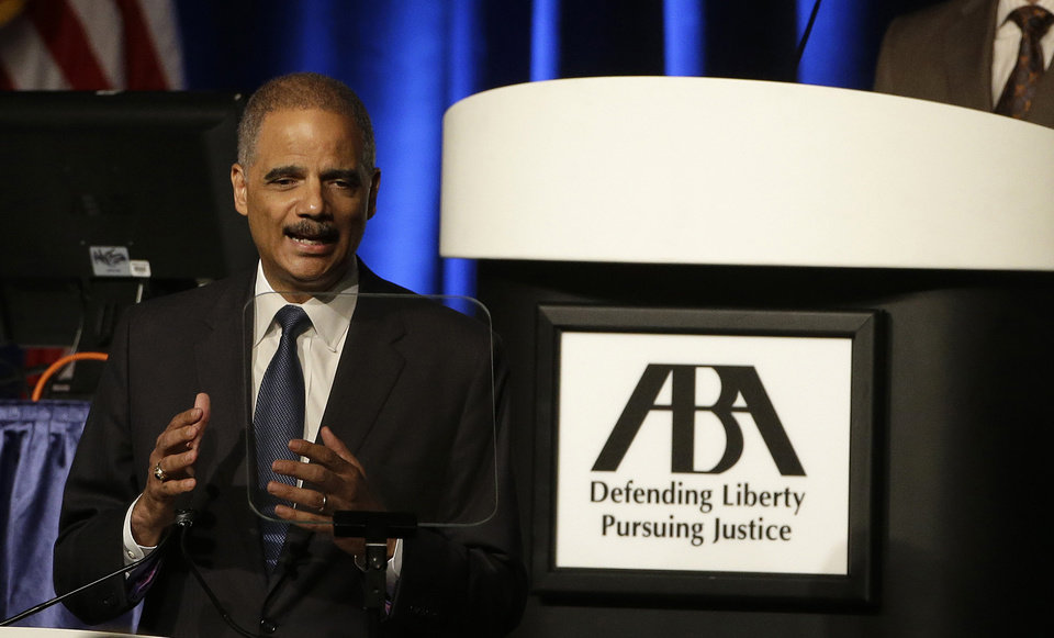 Photo - FILE - This Aug. 12, 2014 file photo shows Attorney Gen. Eric Holder speaking to the American Bar Association Annual Meeting in San Francisco. In remarks to the association, Holder said the Obama administration is calling for major changes to the nation's criminal justice system that would cut back the use of harsh sentences for certain drug-related crimes. Eric Holder, who is leading the federal response to the racial turmoil in Ferguson, Missouri, talks about the nation's civil rights struggles in a way none of the 81 previous U.S. attorneys general could _ by telling his own family story. (AP Photo/Eric Risberg, File)