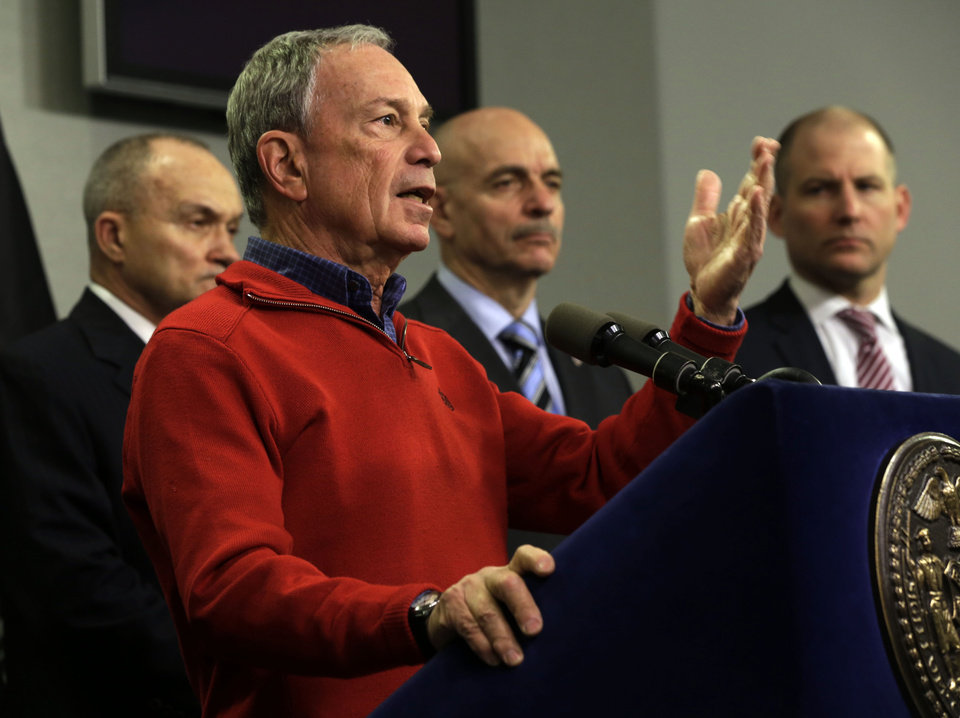 Photo - New York Mayor Michael Bloomberg, foreground, briefs the media about the pending snow storm, at New York City's Office of Emergency Management,  Friday, Feb. 8, 2013. He is accompanied by Police Commissioner Ray Kelly, left, Fire Commissioner Salvatore Cassano, second from right, and Deputy Mayor for Operations Cas Holloway. Snow began to fall as a massive blizzard headed for the American Northeast on Friday, sending residents scurrying to stock up on food and supplies ahead of a storm poised to dump up to 3 feet of  snow from New York City to Boston and beyond.(AP Photo/Richard Drew)