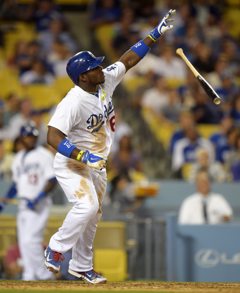 Photo - Los Angeles Dodgers right fielder Yasiel Puig hits a three-run home during the fourth inning of a baseball game against the Miami Marlins, Monday, May 12, 2014, in Los Angeles. (AP Photo)