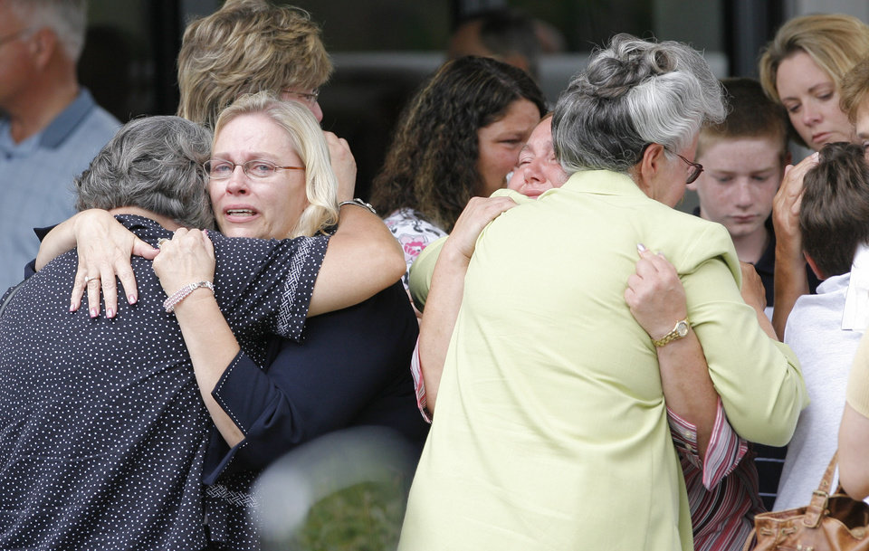 Photo - MURDERS, SHOOTING DEATHS, TAYLOR PLACKER, TAYLOR DAWN PASCHAL-PLACKER , SKYLA JADE WHITAKER, WELEETKA: Teachers, students and friends hug outside Taylor Paschal-Placker funeral in Dewar, Friday, June 13, 2008. Taylor and her friend  Skyla Whitaker were shot and killed last Sunday on the dirt road near one of their homes, Thursday, June 12, 2008.    Photo by David McDaniel/The Oklahoman      ORG XMIT: KOD