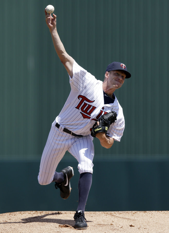 Photo - Minnesota Twins starting pitcher Cole De Vries (38) warms up for the first inning of an exhibition spring training baseball game against the Boston Red Sox in Fort Myers, Fla., Friday, March 29, 2013. (AP Photo/Elise Amendola)