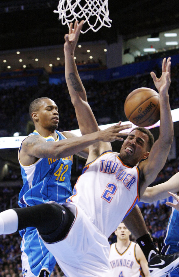 New Orleans Hornets forward Lance Thomas (42) fouls Oklahoma City Thunder guard Thabo Sefolosha (2) during the second quarter of an NBA basketball game in Oklahoma City, Wednesday, Feb. 27, 2013. (AP Photo/Alonzo Adams)