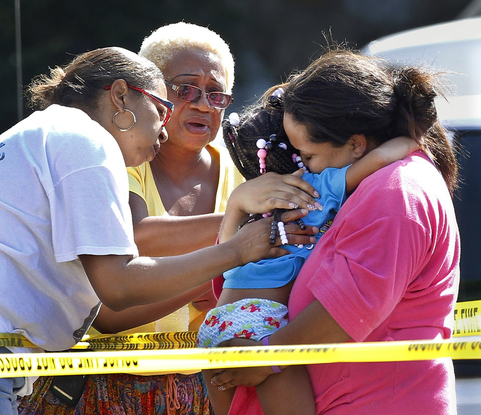 Del City police successfully rescued a small girl from inside a house at 1920 Karen Street Wednesday morning, July 18, 2012. The child was held hostage by a man who refused to come out. He was found dead inside after the girl was removed.  Photo by Jim Beckel, The Oklahoman.