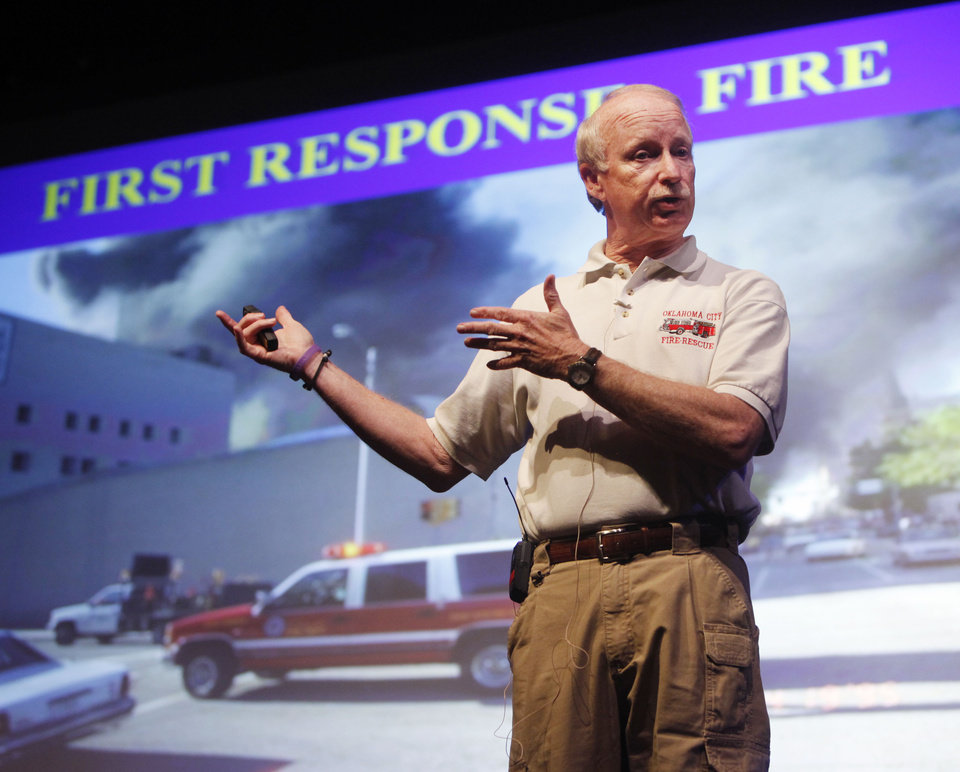 Photo - Jon Hansen, a former Oklahoma City assistant fire chief during the Oklahoma City bombing, speaks in April about his experiences to students at Edmond Memorial High School. Photo by Paul Hellstern, The Oklahoman