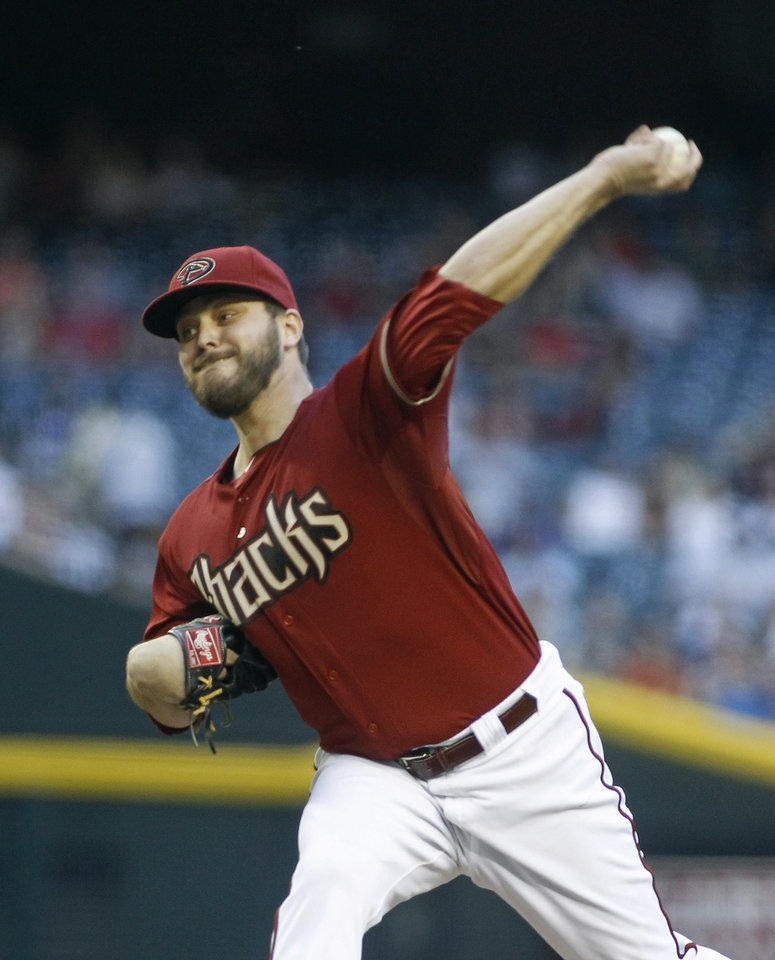 Photo - Arizona Diamondbacks' Wade Miley throws a pitch against the Milwaukee Brewers during the second inning of a baseball game on Wednesday, June 18, 2014, in Phoenix. (AP Photo/Ralph Freso)