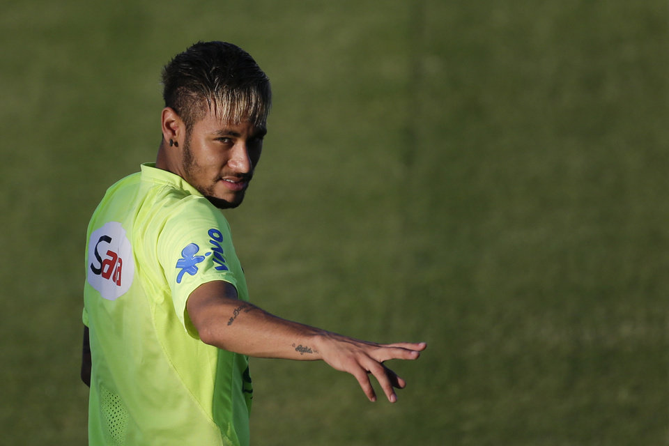 Photo - Brazil's Neymar gestures during a training session in Fortaleza, Brazil, Thursday, July 3, 2014. Brazil will face Colombia on Friday in a quarterfinal soccer match at the World Cup. (AP Photo/Felipe Dana)