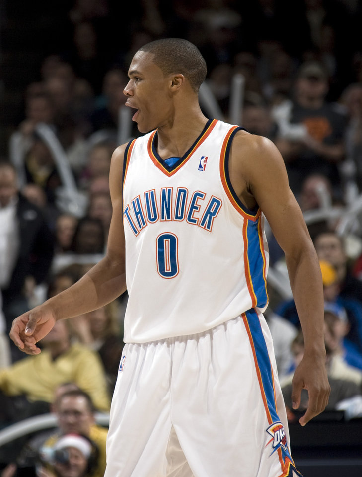 Photo - CELEBRATE / CELEBRATION: Oklahoma City's Russell Westbrook (0) celebrates a Thunder score during the NBA game between the Oklahoma City Thunder and Cleveland Cavaliers, Sunday, Dec. 21, 2008, at the Ford Center in Oklahoma City. PHOTO BY SARAH PHIPPS, THE OKLAHOMAN ORG XMIT: KOD