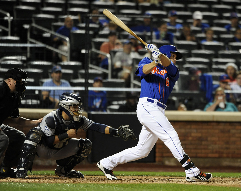 Photo - New York Mets' Matt den Dekker (6) hits a ground rule double  that scored Lucas Duda as Rene Rivera catches for the San Diego Padres in the fourth inning of a baseball game at Citi Field on Friday, June 13, 2014, in New York. (AP Photo/Kathy Kmonicek)