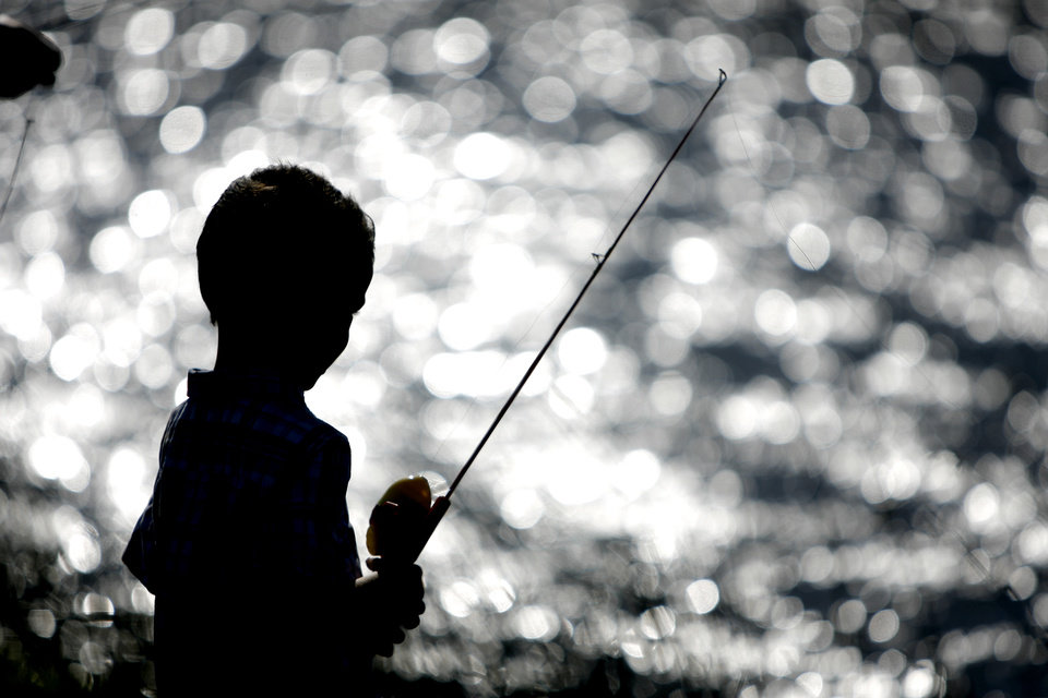 Photo - CHILDREN: Ben Bryant, 5, of Choctaw watches his line during a fishing derby for kids in Choctaw, Okla., Saturday, June 20, 2009. Photo by Bryan Terry, The Oklahoman ORG XMIT: KOD
