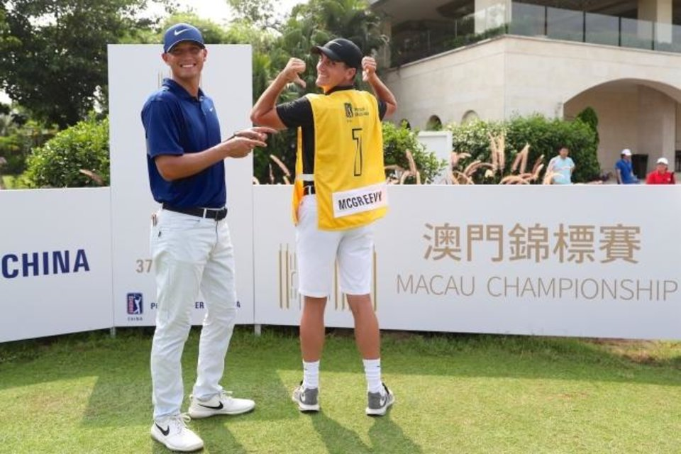 Photo -  Drew Ison caddying for his former Edmond Santa Fe teammate Max McGreevy at the 2019 Macau Championship on the PGA Tour Series – China. [PHOTO PROVIDED]