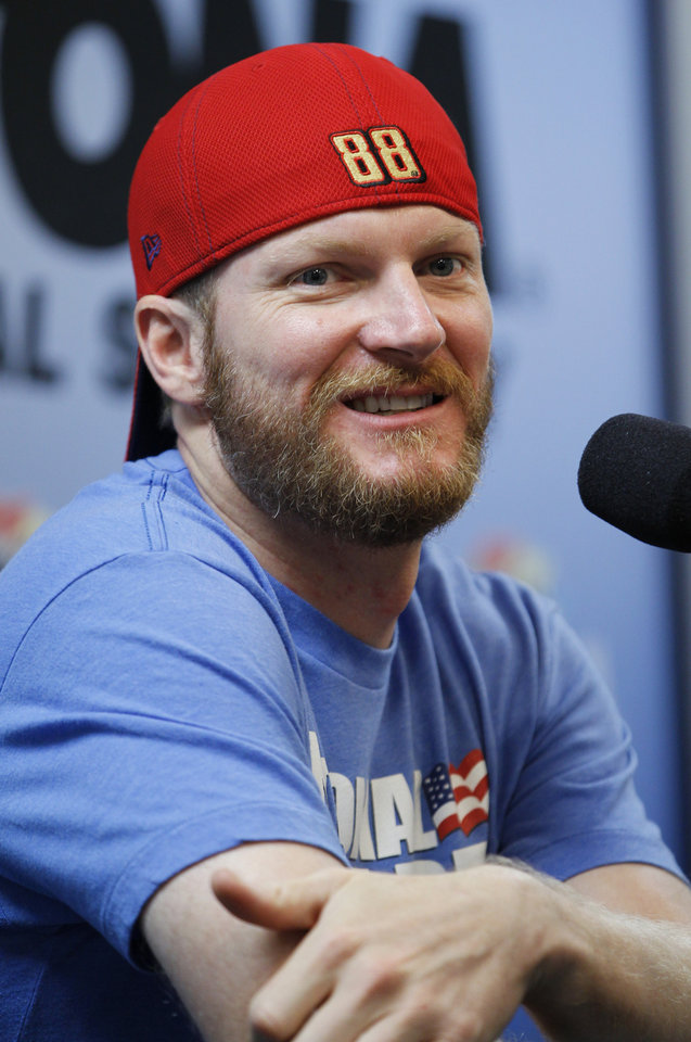 Photo - Driver Dale Earnhardt Jr. answers questions at a news conference before a NASCAR Sprint Cup practice session at Daytona International Speedway in Daytona Beach, Fla., Thursday, July 3, 2014. (AP Photo/Terry Renna)