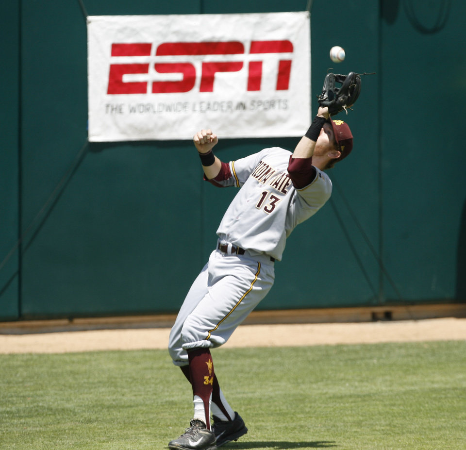 Photo - Arizona State University third baseman Dalton Dinatale catches a fly ball during the second inning of an NCAA college baseball tournament regional game against Sacramento State on Saturday, May 31, 2014, in San Luis Obispo, Calif. (AP Photo/Aaron Lambert)