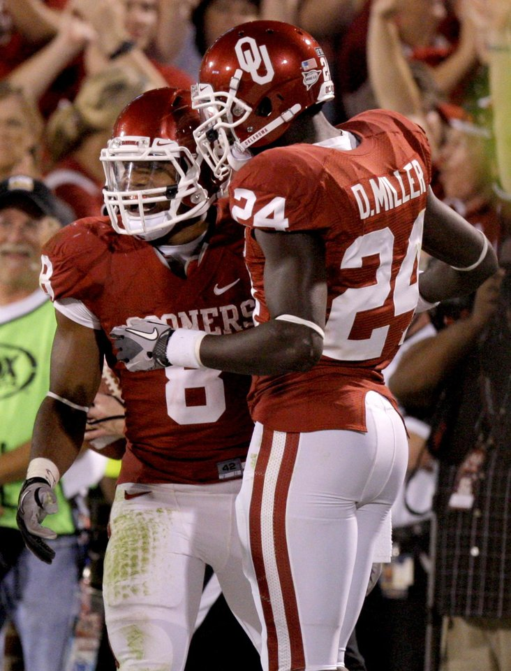 Photo - Oklahoma's Dominique Whaley (8) celebrates with Dejuan Miller (24) after a touchdown during the college football game between the University of Oklahoma Sooners (OU) and the University of Missouri Tigers (MU) at the Gaylord Family-Memorial Stadium on Saturday, Sept. 24, 2011, in Norman, Okla. Photo by Bryan Terry, The Oklahoman