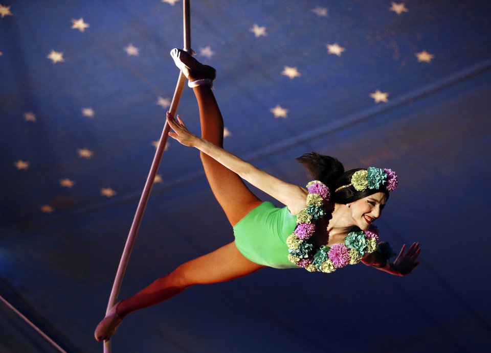 Photo -  An aerialist performs Tuesday in Pauls Valley.  [Photo by Steve Sisney, The Oklahoman]