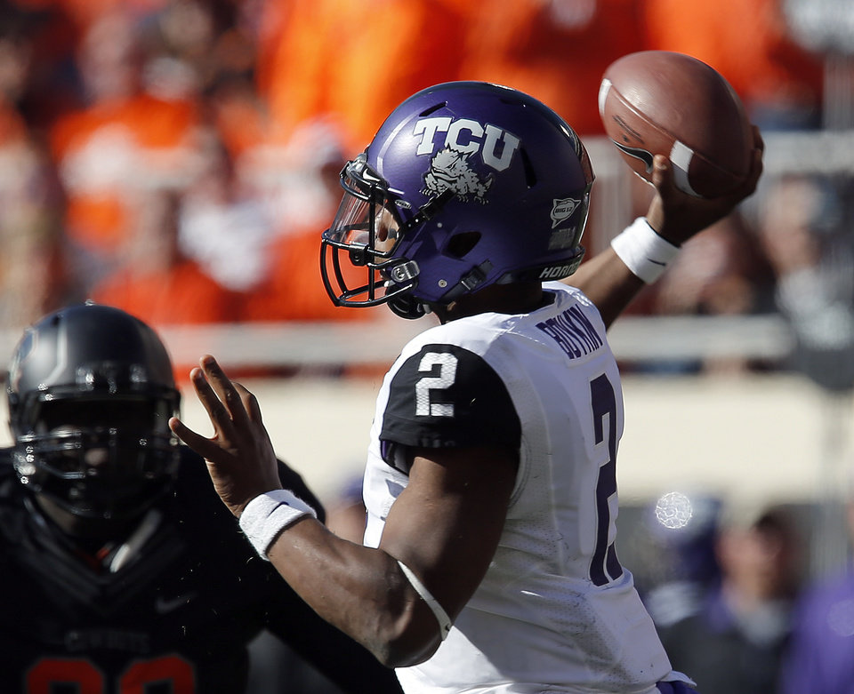 Photo - TCU's Trevone Boykin (2) throws the ball during a college football game between Oklahoma State University (OSU) and Texas Christian University (TCU) at Boone Pickens Stadium in Stillwater, Okla., Saturday, Oct. 27, 2012. Photo by Sarah Phipps, The Oklahoman