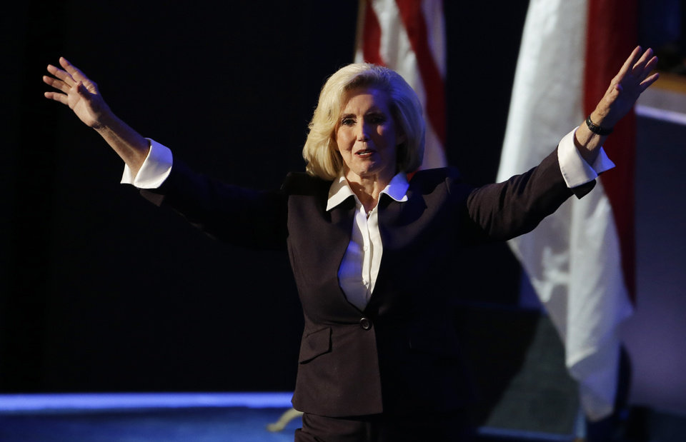 Photo - Women's rights activist Lilly Ledbetter arrives to speak to the Democratic National Convention in Charlotte, N.C., on Tuesday, Sept. 4, 2012. (AP Photo/Lynne Sladky)