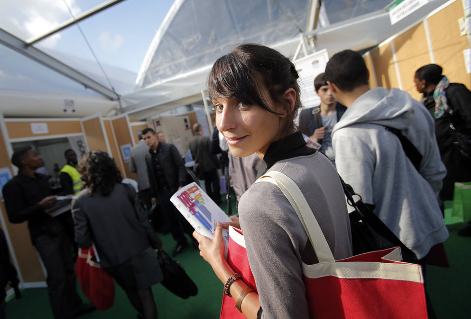 Photo - Estelle Borrell, 24, visits a job fair in Paris, Thursday, Oct. 4, 2012. Estelle Borrell knew she wanted to work in law since she was a teenager, when she interned at a court in Versailles, France.