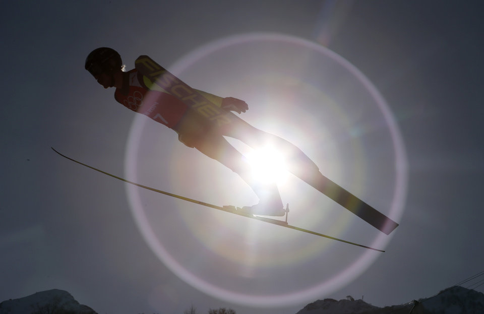 Photo - Czech Republic's Roman Koudelka makes an attempt during the men's normal hill ski jumping training ahead of the 2014 Winter Olympics, Friday, Feb. 7, 2014, in Krasnaya Polyana, Russia. (AP Photo/Dmitry Lovetsky)