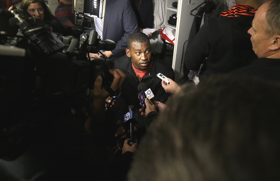 Photo - San Francisco 49ers linebacker Aldon Smith answers questions from reporters in the locker room at an NFL training facility in Santa Clara, Calif., Monday, Jan. 20, 2014. The 49ers lost to the Seattle Seahawks in the NFC Championship Game. (AP Photo/Jeff Chiu)